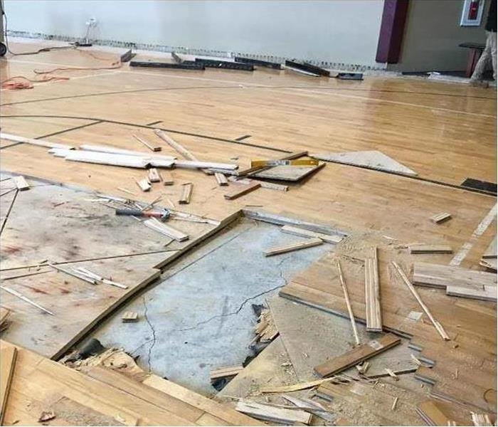 Gym Floor Damaged by Water Before
